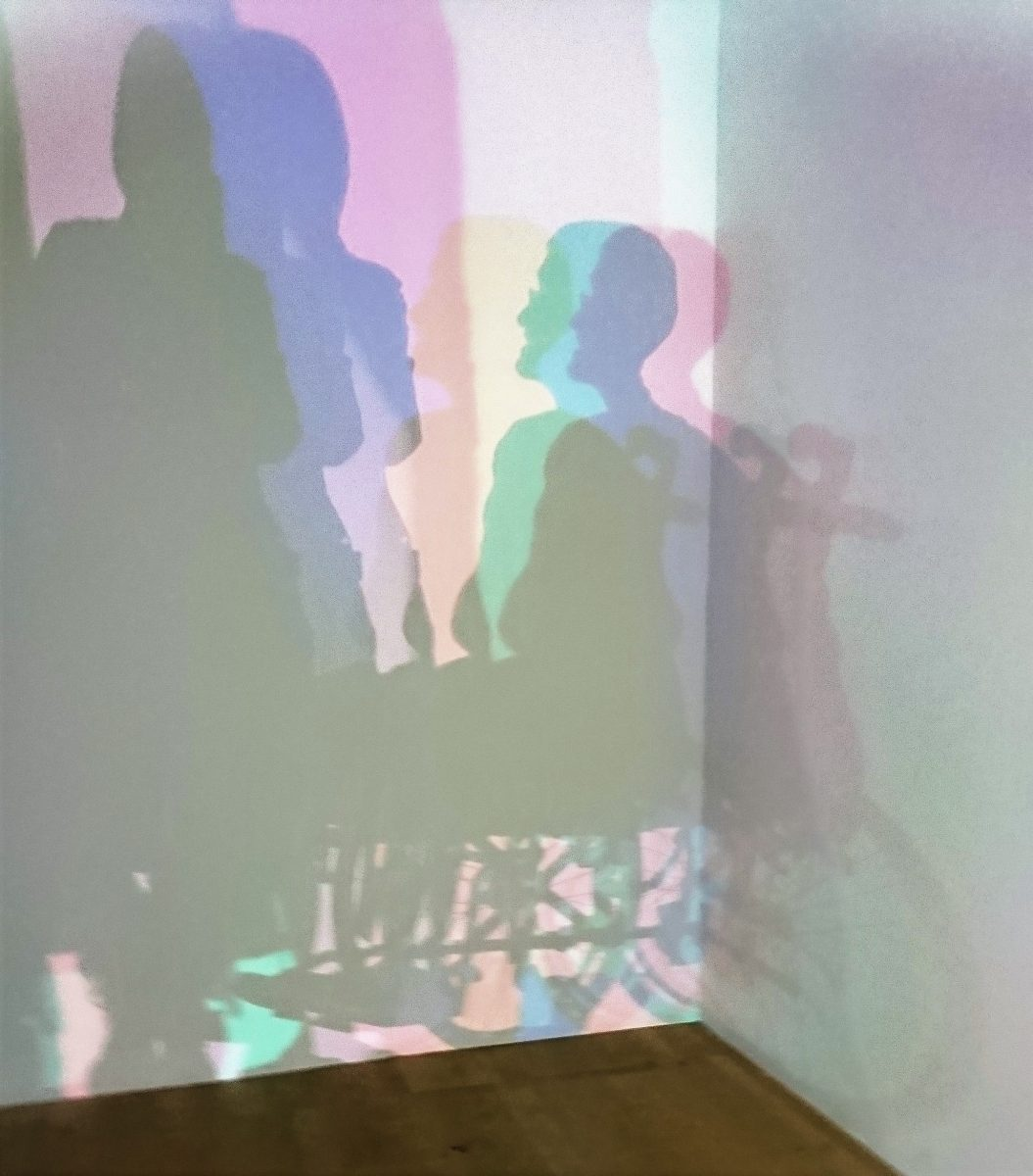 """Picture- Me in my wheelchair in the shadows (in a good way) at the Olafur Eliasson """"In Real Life"""" exhibition at the Tate"""